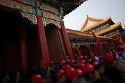 Gugong (Forbidden City, Imperial Palace). Chinese tour group with red caps at Taihe Men gate.