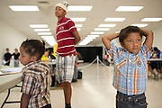 Jaden Singleton, 5, looks on while he waits with his brothers Jacobi, 3, and Matthew, 13, at the Immunization Collaboration of Tarrant County in Fort Worth, Texas on August 30, 2013. The Immunization Collaboration offers low cost vaccines targeting hepatitis, the flu, chickenpox, measles, mumps and HPV amongst other illnesses. (Cooper Neill / for The Texas Tribune)