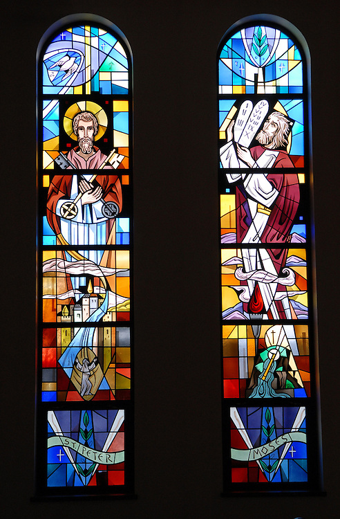 Two stained glass panels inside Our Lady Queen of Peace Church in Milwaukee depict St. Peter and Moses. (Photo by Sam Lucero)
