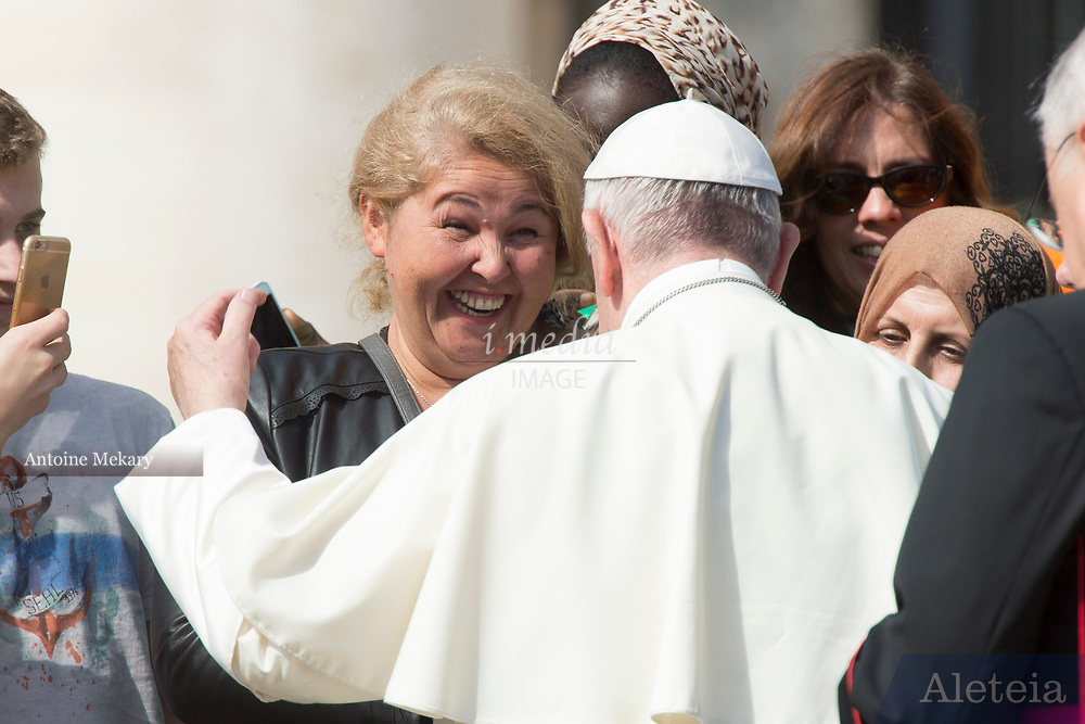 VATICAN CITY, ITALY 27 SEPT 2017: Pope Francis greets a woman at the General Audience in St. Peters Square on Sept. 27, 2017