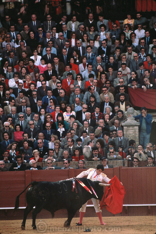Bullfighter with a missing shoe, Seville, Spain.
