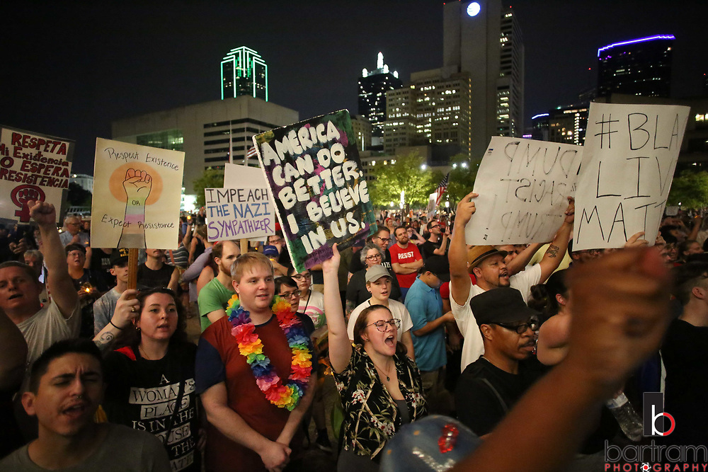 Thousands gather as night falls during an anti white-supremacy rally at Dallas City Hall plaza on Saturday, Aug. 19, 2017. (Photo by Kevin Bartram)