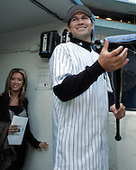 Johnny Damon and wife Michelle enter the dugout after a press confrence introducing him to the New York Media New York. Friday 23 December 2005 Andrew Gombert for the Boston Globe