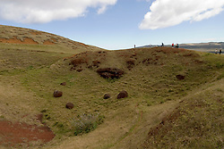 Chile, Easter Island: Puna Pau, the quarry for red stone topknots that were put on the statues or moai.  Most Moai were believed to have these multi-ton hats..Photo #: ch303-33661..Photo copyright Lee Foster www.fostertravel.com lee@fostertravel.com 510-549-2202