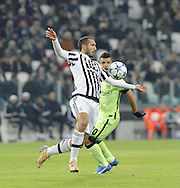 Giorgio Chiellini of Juventus and Sergio Aguero of Manchester City during the UEFA Champions League match at Juventus Stadium, Turin<br /> Picture by Stefano Gnech/Stella Pictures Ltd +39 333 1641678<br /> 25/11/2015