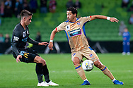 Newcastle Jets defender Daniel Georgievski (17) controlling the ball against Melbourne City midfielder Lachlan Wales (19) at the FFA Cup Round 16 soccer match between Melbourne City FC v Newcastle Jets at AAMI Park in Melbourne.