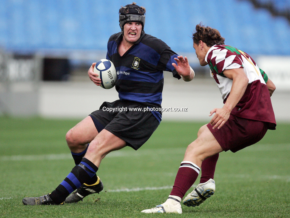 Matt Kirke looks to fend off James Asekona during the Gallaher Shield Final between Ponsonby and Waitakere at Eden Park, Auckland, New Zealand on Saturday 30 July, 2005. Ponsonby won the match, 19 - 17. Photo: Hannah Johnston/PHOTOSPORT