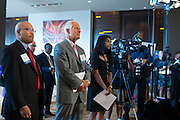 (L to R) Desoto (Texas) Mayor Carl Sherman and Akron (Ohio) Mayor Don Plusquellic look on during a press conference at the United States Conference of Mayors 82nd annual meeting at the Omni Hotel in Dallas, Texas on June 20, 2014.  (Cooper Neill for The New York Times)