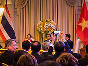 23 JULY 2015 - BANGKOK, THAILAND: A member of the Vietnamese delegation uses his smart phone to snap a picture of NGUYEN TAN DUNG (left), Prime Minister of Vietnam,  and PRAYUTH CHAN-O-CHA, Prime Minister of Thailand, (right) at a ceremony for signing bilateral agreements between Thailand and Vietnam at Government House in Bangkok. The Vietnamese Prime Minister and his wife came to Bangkok for the 3rd Thailand - Vietnam Joint Cabinet Retreat. The Thai and Vietnamese Prime Minister discussed issues of mutual interest.      PHOTO BY JACK KURTZ