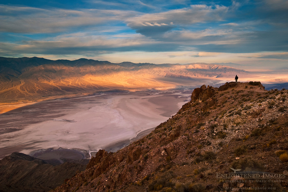 Tourist overlooking Panamint Mountains over Badwater Basin,  from Dantes View, Death Valley National Park, California