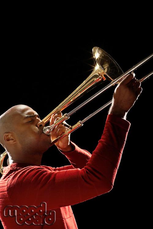 Man Playing Trombone close-up side view