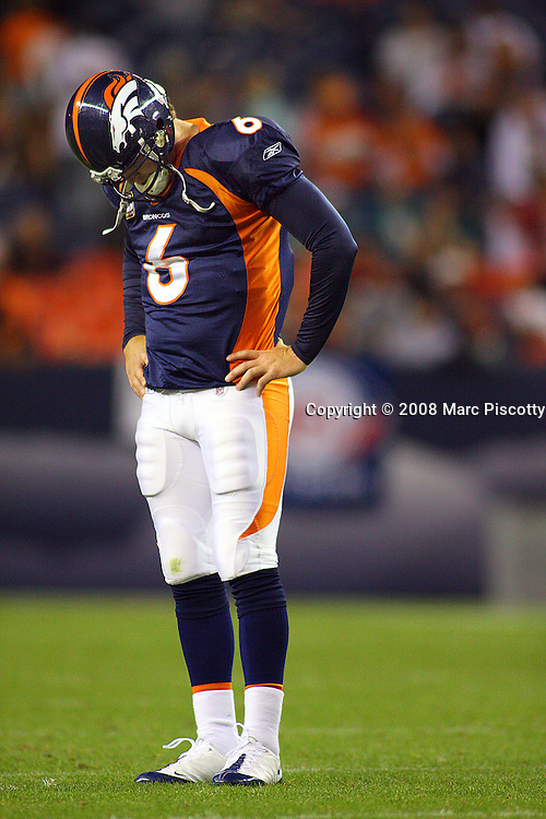SHOT 11/2/08 6:06:43 PM - Denver Broncos quarterback Jay Cutler hangs his head after an incomplete pass late in the game against the Miami Dolphins during the fourth quarter of their NFL football game at Invesco Field in Denver, Co. November 2, 2008. Cutler threw three interceptions in the game. The Broncos lost the game 26-17..(Photo by Marc Piscotty / © 2008)