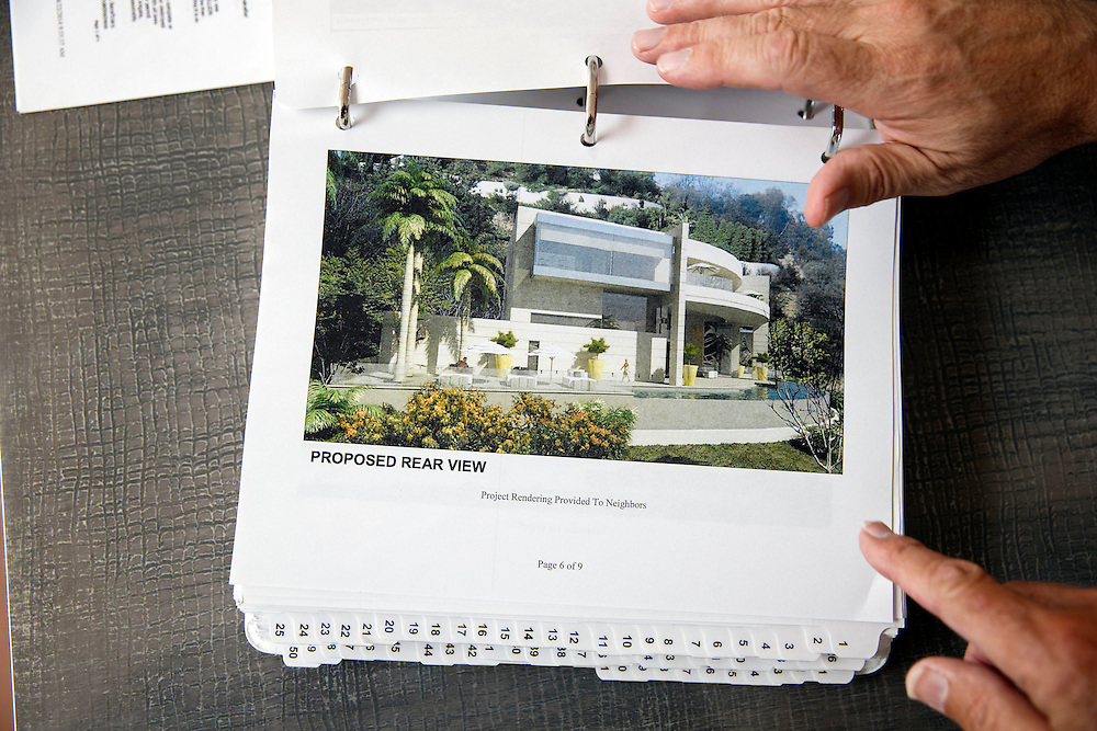 Joseph Horacek shows documents with a pictures of the proposed rendering of the mansion Mohamed Hadid had planned to build at 901 Strada Vecchia in the Bel Air neighborhood of Thursday, July 16, 2015 in Los Angeles, California. Photo by Patrick T. Fallon for DailyMail.com