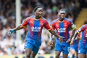 Jeffrey Schlupp (15) of Crystal Palace celebrates after scoring goal during the Premier League match between Fulham and Crystal Palace at Craven Cottage, London, England on 11 August 2018.