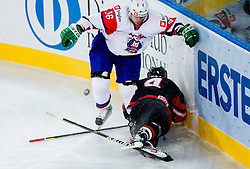 Ales Music of Slovenia vs Aaron Keller of Japan during ice-hockey match between Slovenia and Japan at IIHF World Championship DIV. I Group A Slovenia 2012, on April 16, 2012 in Arena Stozice, Ljubljana, Slovenia. (Photo by Vid Ponikvar / Sportida.com)