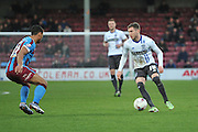 Danny Mayor (10) of Bury and Jordan Clarke of Scunthorpe United during the Sky Bet League 1 match between Scunthorpe United and Bury at Glanford Park, Scunthorpe, England on 19 April 2016. Photo by Ian Lyall.