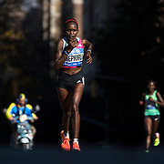NYTRUN - NOV. 6, 2016 - NEW YORK - Joyce Chepkirui, foreground, who would go on the finish fourth in 02:29:08, behind Molly Huddle, runs south along 5th Avenue, just north of E 90th Street, as she competes in the 2016 TCS New York City Marathon on Sunday. NYTCREDIT:  Karsten Moran for The New York Times **PLS CHECK FINISH PLACE AND TIMES