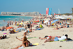 Busy beach near Marina at New Dubai in United Arab Emirates
