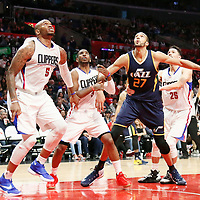 25 March 2016: Utah Jazz center Rudy Gobert (27) vies for the rebound with LA Clippers guard Chris Paul (3, LA Clippers guard Austin Rivers (25) and LA Clippers center Marreese Speights (5) during the Los Angeles Clippers 108-95 victory over the Utah Jazz, at the Staples Center, Los Angeles, California, USA.