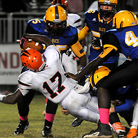 New Hanover's 17 gains yardage agains Laney Friday October 17, 2014. (Jason A. Frizzelle)