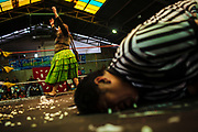 """Maria Eugenia Herrera Mamani, alias """"Claudina the Cursed"""", celebrates her victory by defeating her opponent and even to the referee during a wrestling match every Sunday, in El Alto, Bolivia, February 19, 2012."""