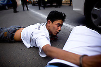 Suspected subjects are detained in the murder of a bus patron who was shot dead in the back of a public bus in Zone 10 Guatemala City Guatemala, 15 January   2009. These suspected gun men were apprehended about a mile away from the murder scene.