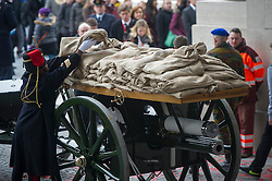 Pic Shows  an<br /> especially adapted WW1 era gun carriage of the King's Troop Royal House Artillery being loaded with the soil from 70 different Flanders battlefields and Commonwealth war Grave Cemeteries.<br /> The Duke of Edinburgh at the Menin Gate in Ypres, Belgium, at a ceremony on Armistice Day to mark the gathering of soil for the Flanders Fields Memorial Garden at the Guards Museum in London, United Kingdom. Monday, 11th November 2013. Picture by i-Images