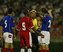 BELGRADE, SERBIA & MONTENEGRO - Wednesday, August 20, 2003: Referee Anders Frisk gets annoyed with Serbia & Montenegro's Mladen Krstajic as Wales' Nathan Blake looks on during the UEFA European Championship qualifying match at the Red Star Stadium. (Pic by David Rawcliffe/Propaganda)