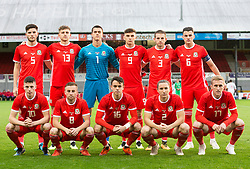 NEWPORT, WALES - Tuesday, October 16, 2018: Wales line up for a team photo ahead of the UEFA Under-21 Championship Italy 2019 Qualifying Group B match between Wales and Switzerland at Rodney Parade. Back row left to right: Ciaran Harries, Keston Davies, Owen Evans, Thomas Harris, Rhys Norrington Davies, Regan Poole.Front row left to right: Nathan Broadhead, Joseff Morrell, Robbie Burton, Aaron Lewis and Connor Evans(Pic by Laura Malkin/Propaganda)