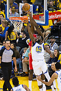 Golden State Warriors forward Draymond Green (23) stops a dunk against the Houston Rockets during Game 6 of the Western Conference Finals at Oracle Arena in Oakland, Calif., on May 26, 2018. (Stan Olszewski/Special to S.F. Examiner)