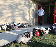 Aplington-Parkersburg head coach Ed Thomas walks around outside Turkey Valley High School while his players get ready for a game in Jackson Junction, Iowa on October 3, 2008. (Stephen Mally / Special to The Denver Post)