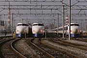 Shinkansen bullet trains in the train station in Tokyo, Japan.