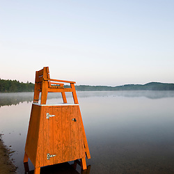 A lifeguard chair on Otter Lake at the beach in Greenfield State Park in Greenfield, New Hampshire.