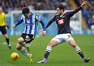 Fernando Forestieri of Sheffield Wednesday in action with George Thone of Derby County during the Sky Bet Championship match at Hillsborough, Sheffield<br /> Picture by Graham Crowther/Focus Images Ltd +44 7763 140036<br /> 06/12/2015