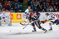 KELOWNA, CANADA - OCTOBER 22: Tyrell Goulbourne #12 of the Kelowna Rockets takes a shot on net of the Calgary Hitmen on October 22, 2013 at Prospera Place in Kelowna, British Columbia, Canada.   (Photo by Marissa Baecker/Shoot the Breeze)  ***  Local Caption  ***