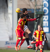 17th February 2018, Firhill Stadium, Glasgow, Scotland; Scottish Premier League Football, Partick Thistle versus Dundee; Sofien Moussa of Dundee outjumps Mustapha Dumbuya of Partick Thistle