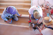 Habitat for Humanity Tucson volunteers framing a new house.