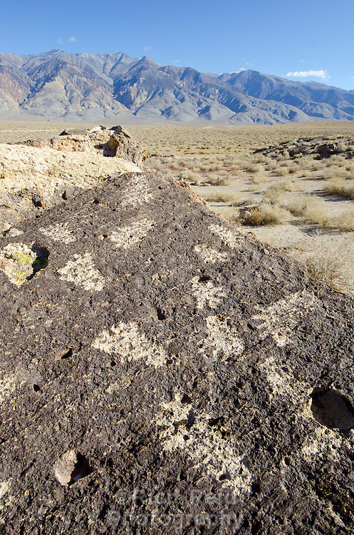 Owens Valley Paiute footprint petroglyphs and the White Mountains in the Eastern Sierras, California.