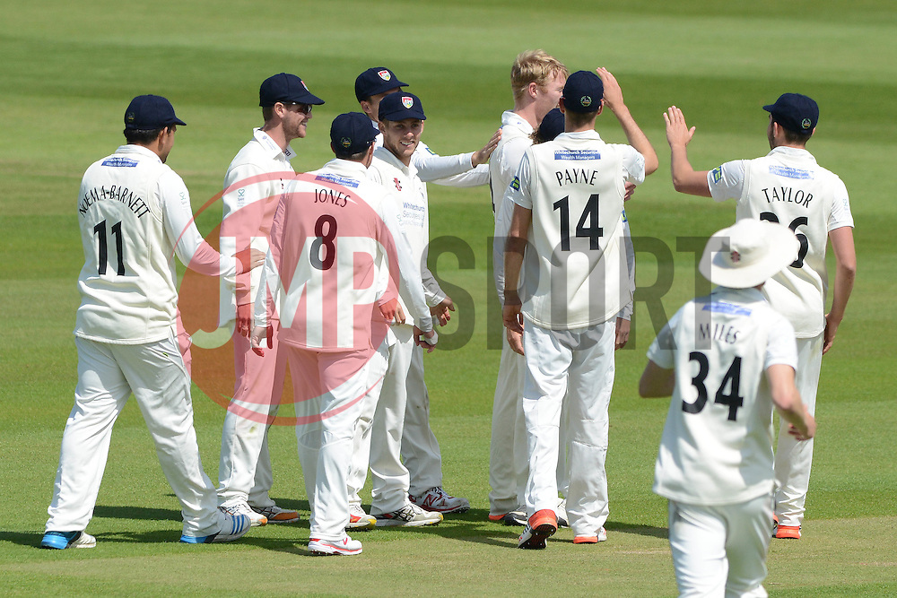 Liam Norwell of Gloucestershire celebrates with his team mates after Brendan Nash of Kent is out - Photo mandatory by-line: Dougie Allward/JMP - Mobile: 07966 386802 - 21/05/2015 - SPORT - Cricket - Bristol - County Ground - Gloucestershire v Kent - LV=County Cricket