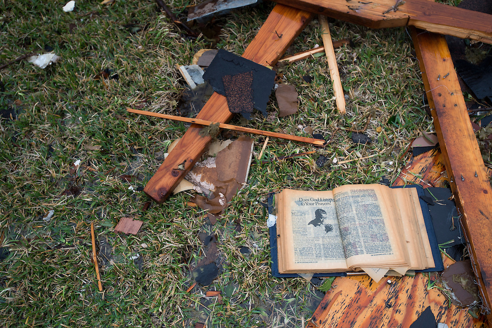 A book sits among debris in the yard of a home where a tornado hit the previous evening in Garland, Texas on December 27, 2015. (Cooper Neill for The New York Times)