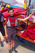 AT5BW7 Young boy with his Mirror dinghy sailing boat