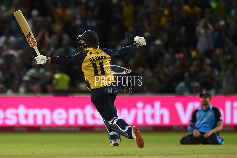 Simon Harmer of Essex Eagles runs in celebration as he hits the winning runs as Riki Wessels sinks to his knees  during the Vitality T20 Finals Day 2019 match between Worcestershire County Cricket Club and Essex County Cricket Club at Edgbaston, Birmingham, United Kingdom on 21 September 2019.