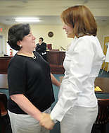 OTTSVILLE, PA - JUNE 17: Diane Chronister (L) and Kelly Jennings (R) share a moment after being married by District Judge Gary Gambardella June 17, 2014 in Ottsville, Pennsylvania. The judge recently announced that he will be holding evening ceremonies in case same-sex couples find it difficult to get married now that the state's ban on same-sex marriage was struck down by a federal court. (Photo by William Thomas Cain/Cain Images)
