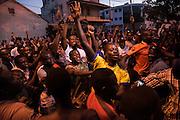BANJUL, GAMBIA - JAN 22: CIvilians celebrate ECOWAS forces as they enter Banjul on 22 January 2017 in Banjul, Gambia.