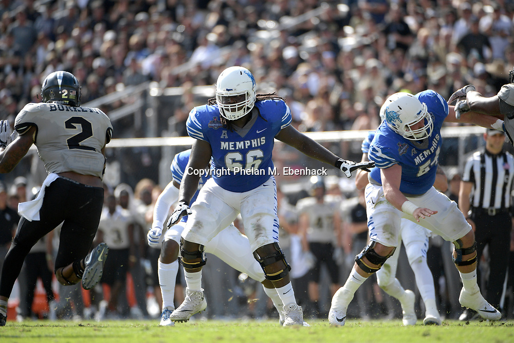 Memphis offensive lineman Roger Joseph (66) sets up to block during the first half of the American Athletic Conference championship NCAA college football game against Central Florida Saturday, Dec. 2, 2017, in Orlando, Fla. (Photo by Phelan M. Ebenhack)