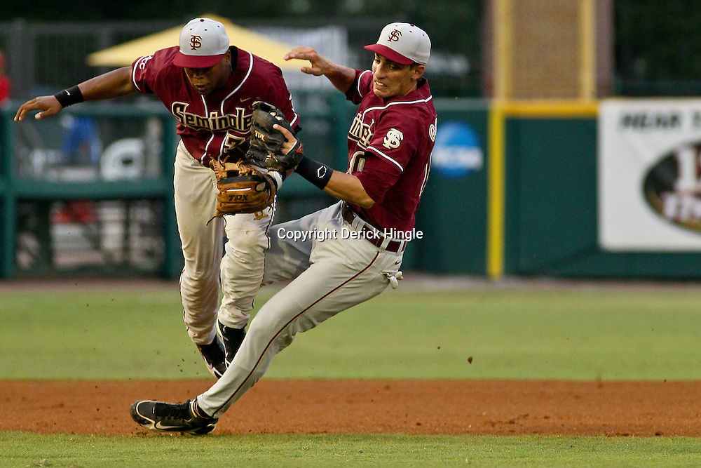 June 04, 2011; Tallahassee, FL, USA; Florida State Seminoles third baseman Sherman Johnson (32) collides with short stop Justin Gonzalez (10) during the first inning of the Tallahassee regional of the 2011 NCAA baseball tournament against the Alabama Crimson Tide at Dick Howser Stadium. Mandatory Credit: Derick E. Hingle
