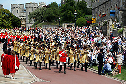 Household Cavalry guards march before the annual Order of the Garter Service at St George's Chapel, Windsor Castle.