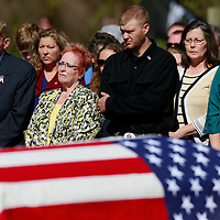 Thomas Wells | BUY AT PHOTOS.DJOURNAL.COM<br /> Albert Mason, from left, his wife, Jeanne, and her grandson, Trever Barton, put to rest the remains of mason's brother, George, on Tuesday. George was deemed missing in action on Feb. 14, 1951 during the Korean War.