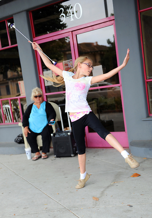Gabriela Scaroni, 11, practices her solo routine while coach Linda Aguilar of the California Classics Baton Club looks on. The Salinas group will be sending a five-person team to compete next week at the U.S. National Twirling Championships in Stockton, CA, while seven members will offer individual routines.