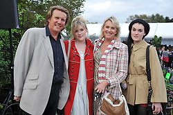 THEO & LOUISE FENNELL and their daughters COCO and EMERALD at the unveiling of 'Isis' a sculpture by Simon Gudgeon hosted by the Royal Parks Foundation and the Halcyon Gallery by the banks of The Serpentine, Hyde Park, London on 7th September 2009.